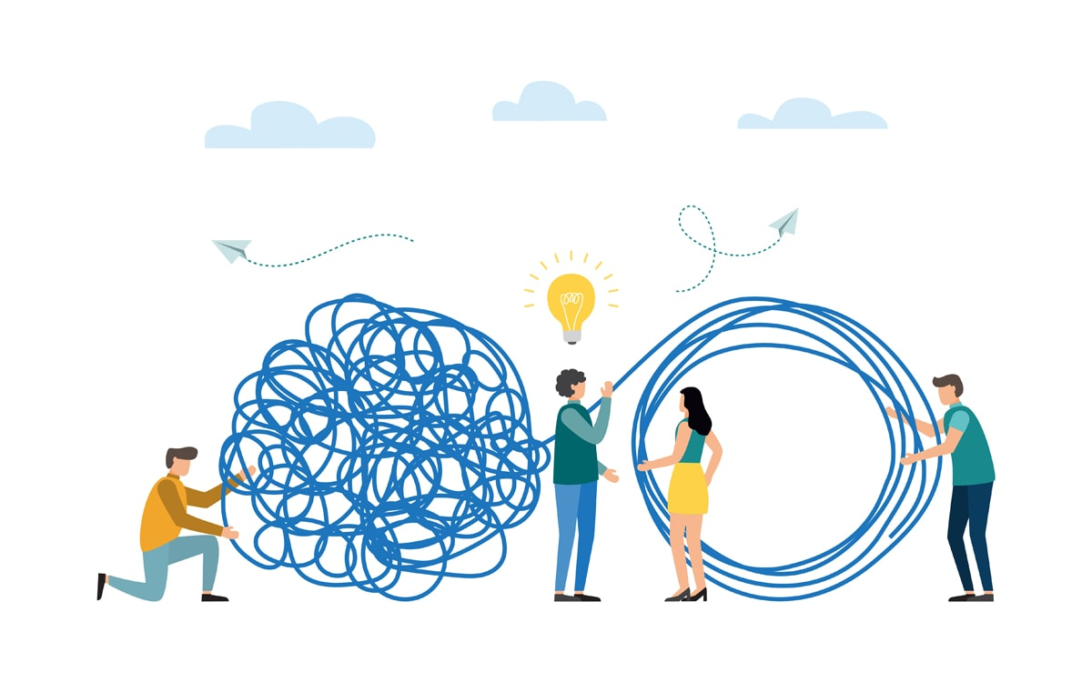 People untangling a ball of yarn together