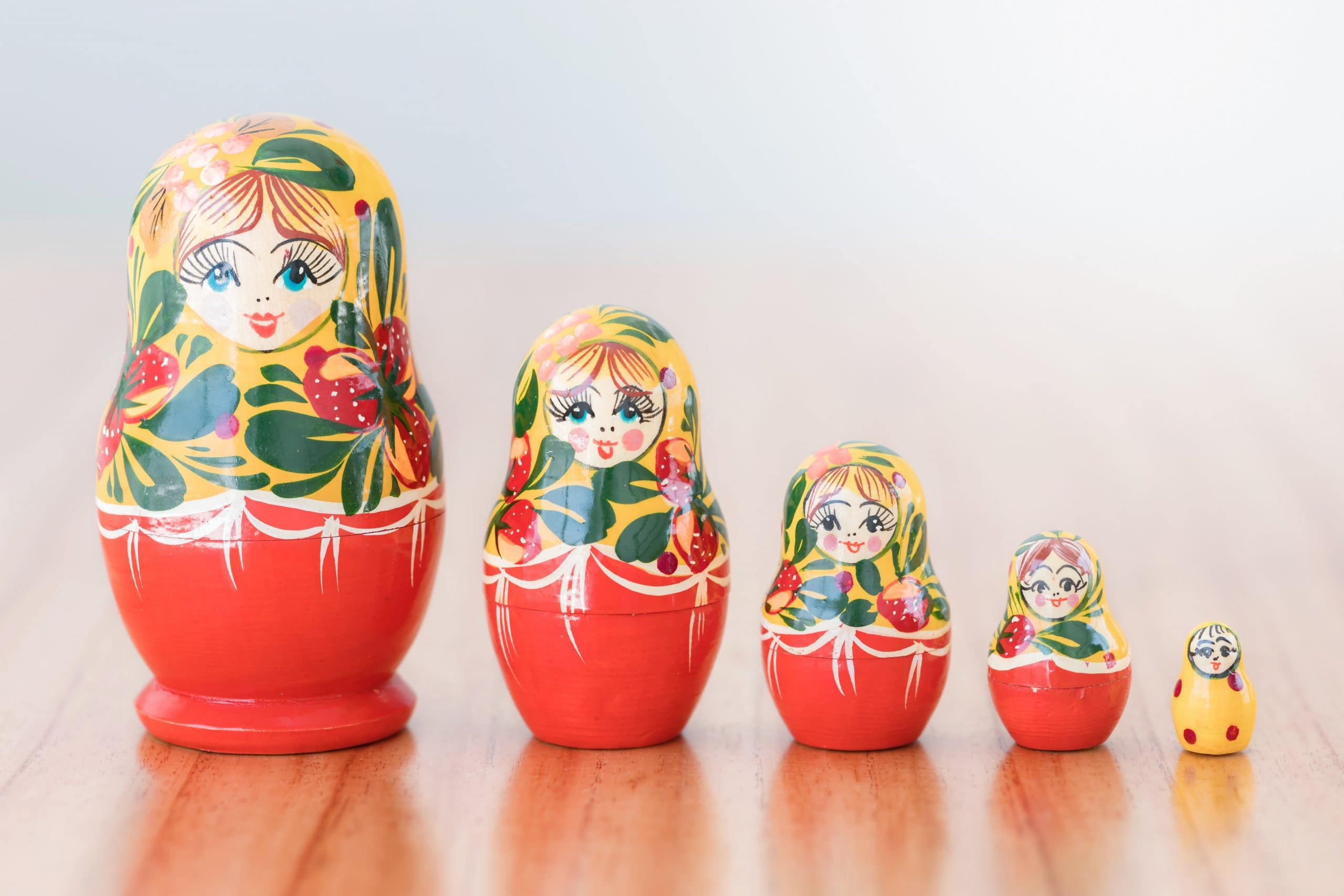 Russian nesting dolls standing in a line