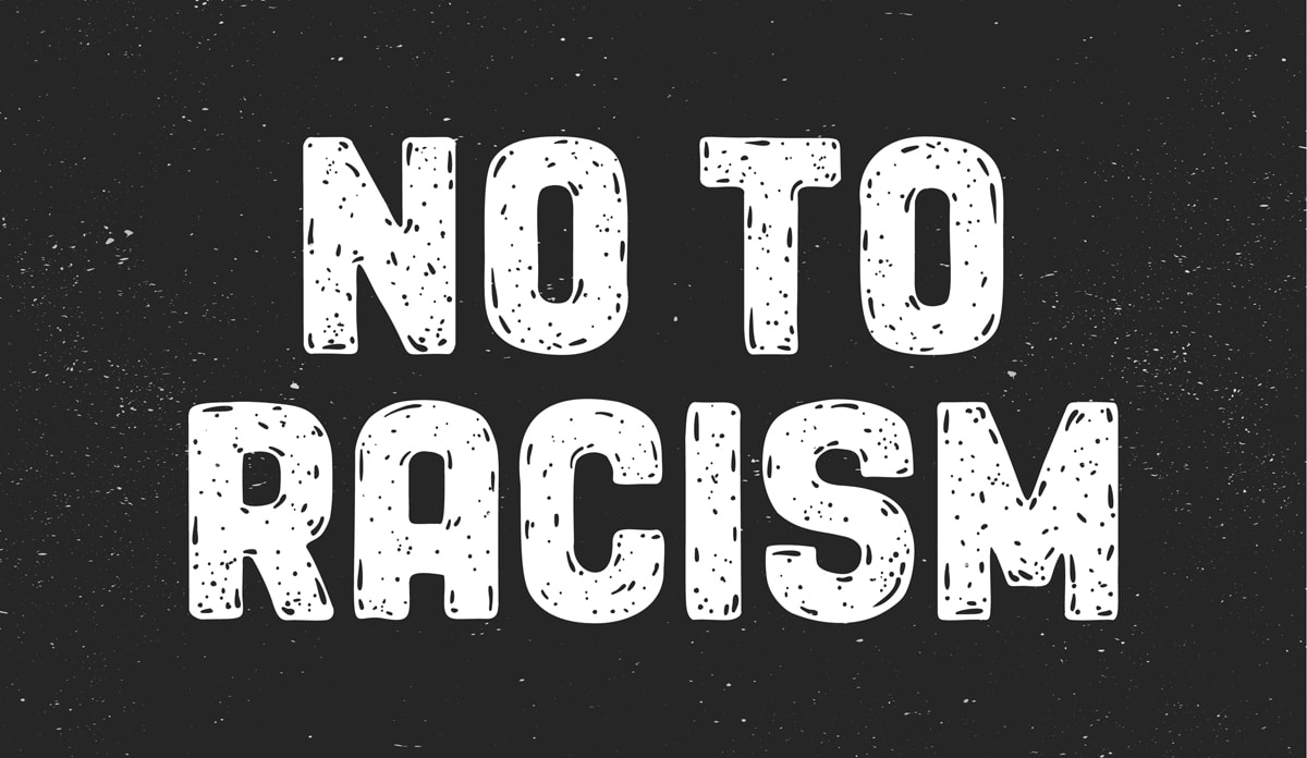 "White letters on black background that read ""NO TO RACISM"""