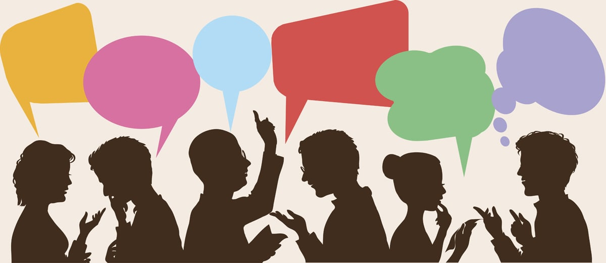 Silhouettes of people with colorful speech bubbles