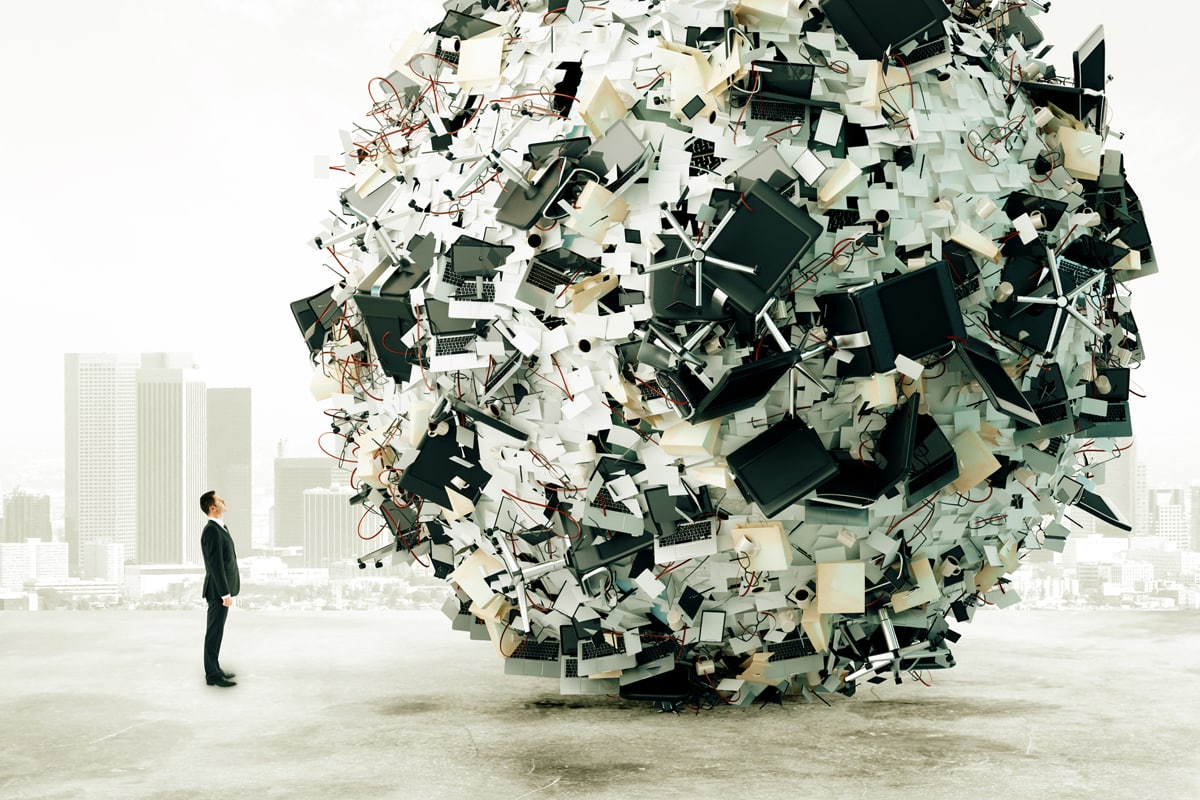 Businessman is looking at the big load of office work