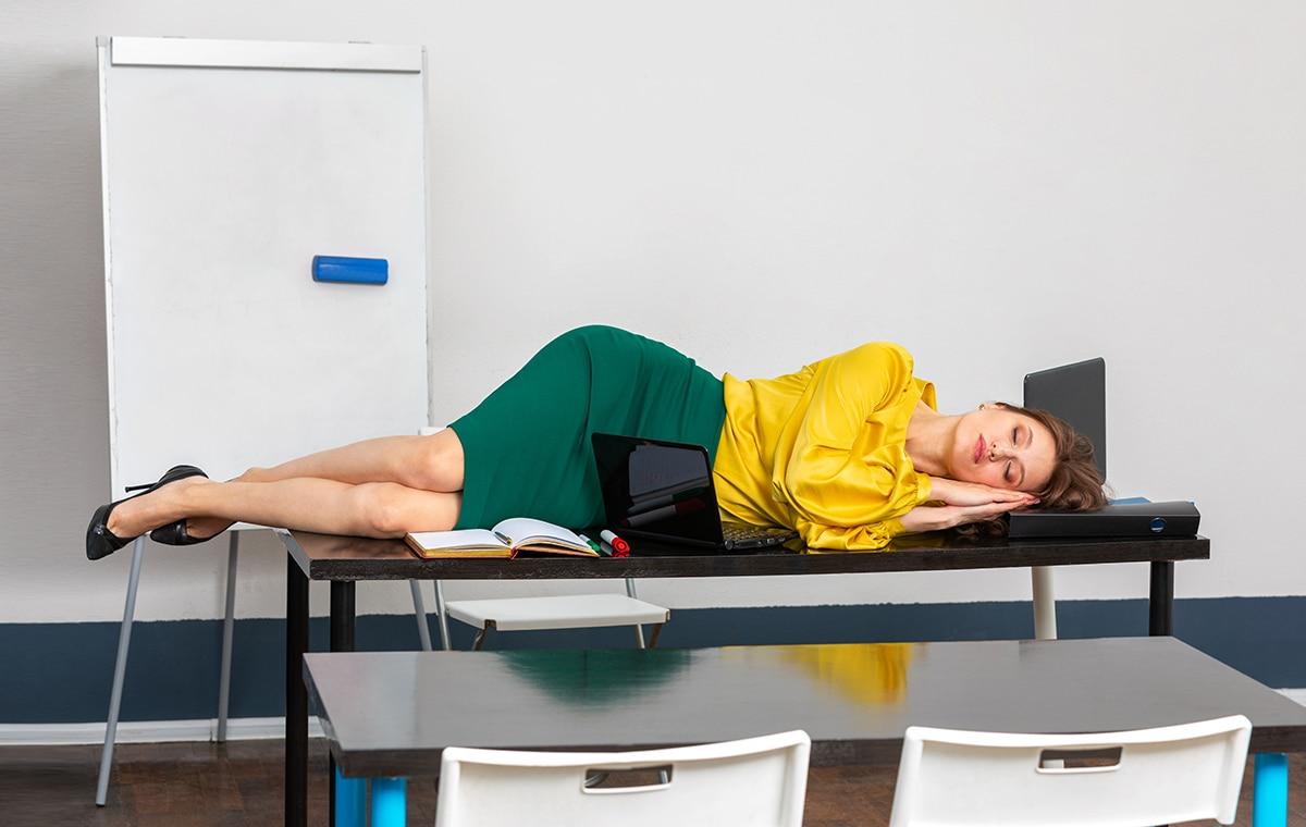 teacher sleeping on top of her desk