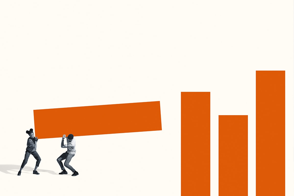 Man and woman carrying large orange bar graph