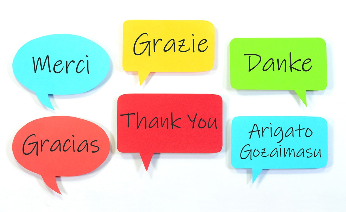 Thank You written in different languages on speech bubbles.