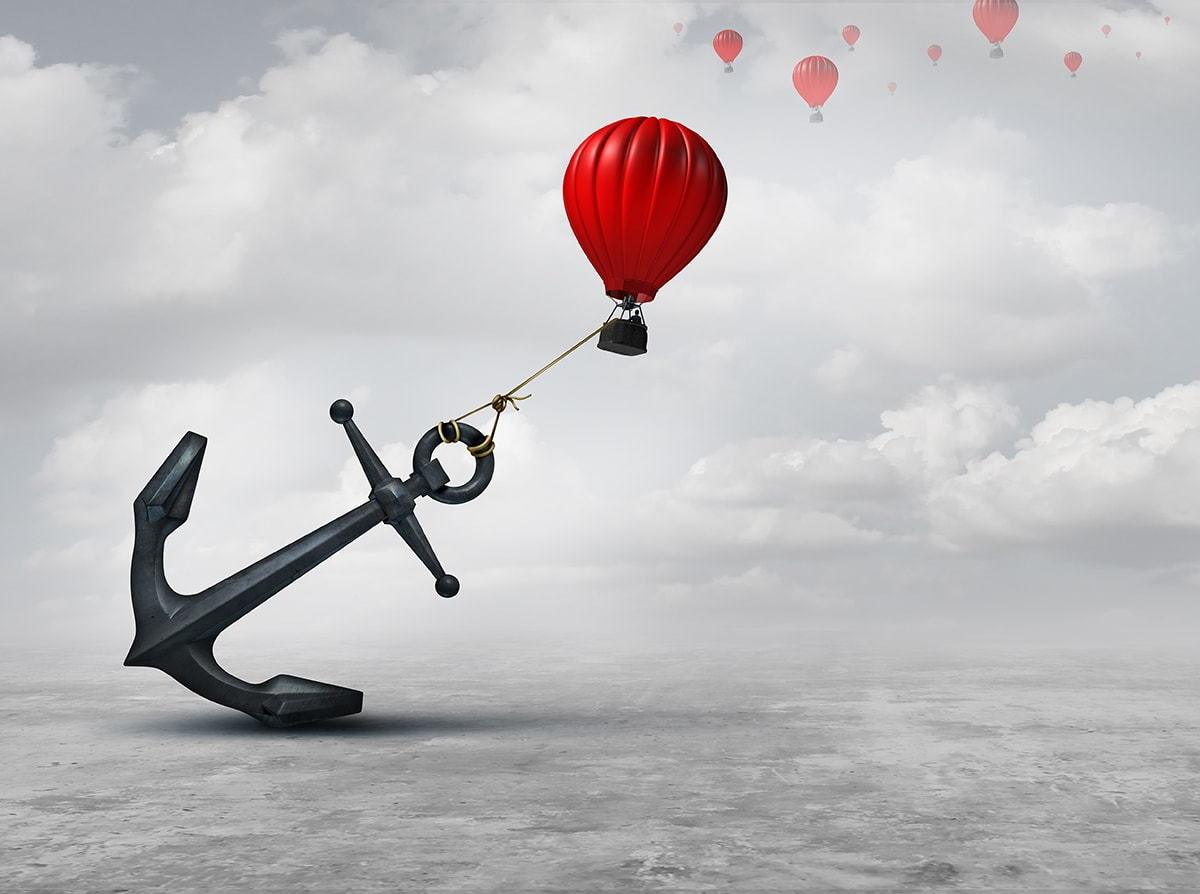 Held back metaphor as a large anchor holding or oppressing an air balloon and restricting movement